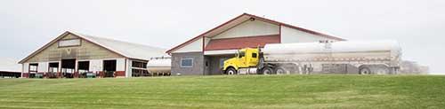 milk trcuk in fron tof dairy barn